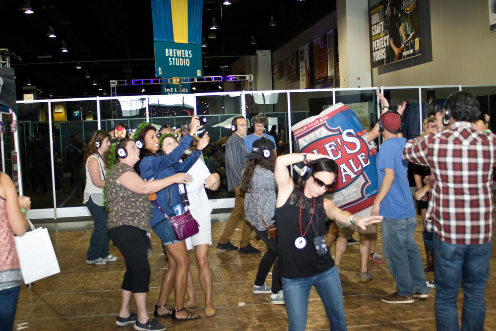 The silent disco area at GABF this year was a major hit. Attendees had a lot to do besides drink beer with games (corn hole) and sponsor booths to explore.  - Photo Angie Wright