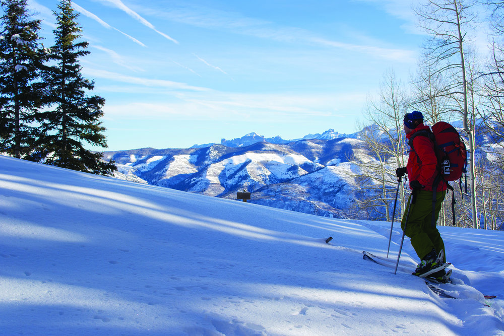 The view from Moonshine Park provides a stunning panorama of the Cimarron Range. Deep-powder turns can be found there.