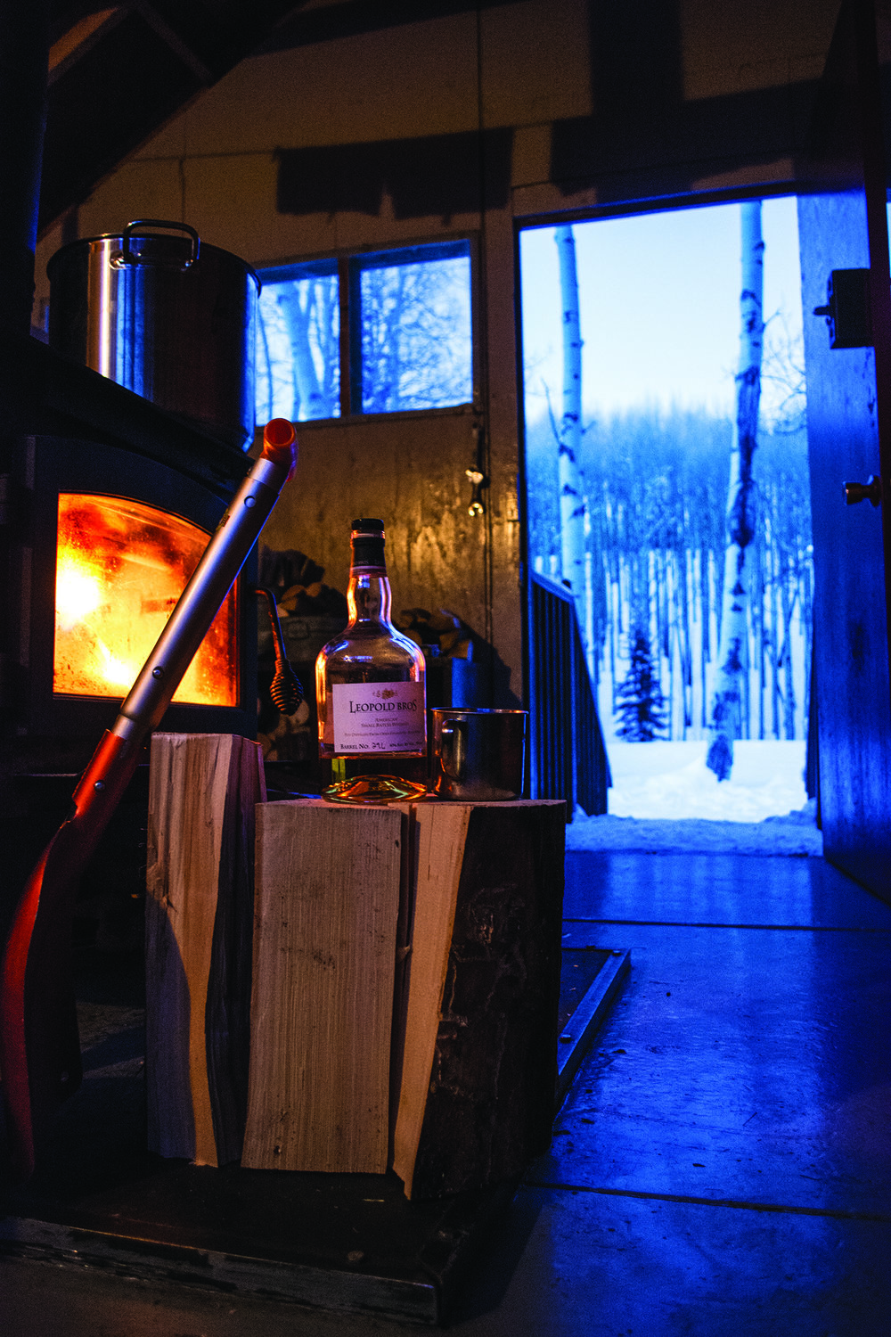 A hard day of skiing calls for a dram of Leopold's whiskey while the fire roars at the Burn Hut.