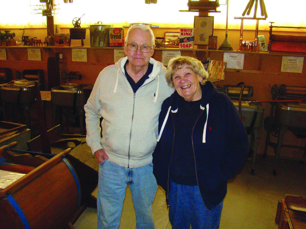 Lee Maxwell and his wife of 65 years, Barbara, pose at their Washing Machine Museum in Eaton.  Photo courtesy Lee Maxwell