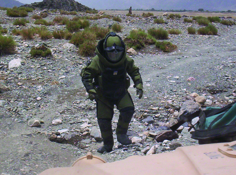 First Sgt. Mike Girard conducts counter-explosive operations in his bomb suit along the Pech River in Afghanistan in 2006. Photo: Courtesy Mike Girard
