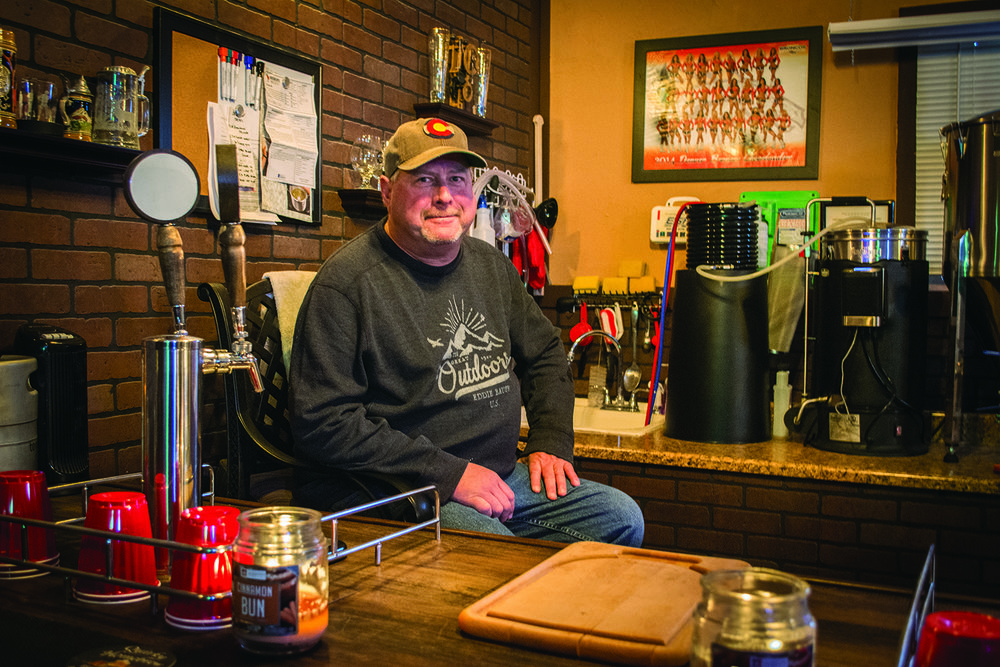Mike Anderson takes a break at his home brewpub in Fort Lupton.