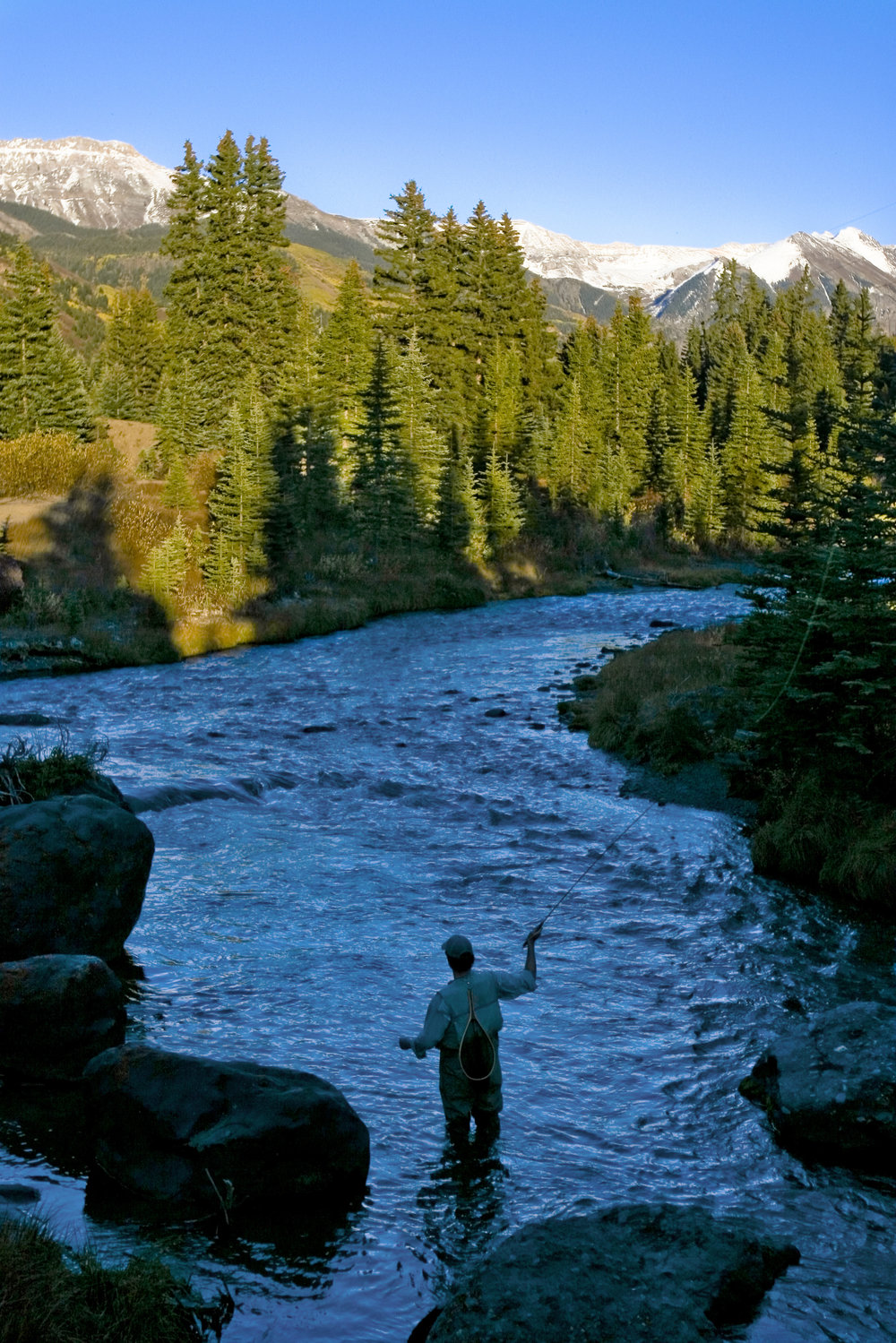 Fly-fishing for trout near Telluride. Photo: Matthew Inden/Miles