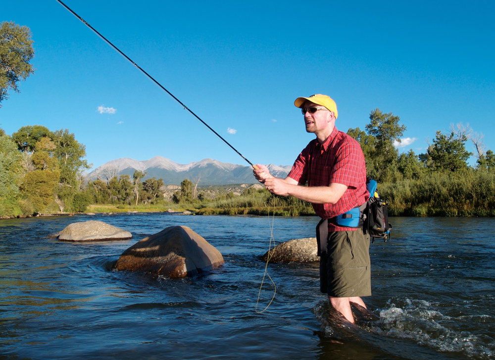 A fisherman throws in some lines in the Arkansas River near Salida, Colorado.