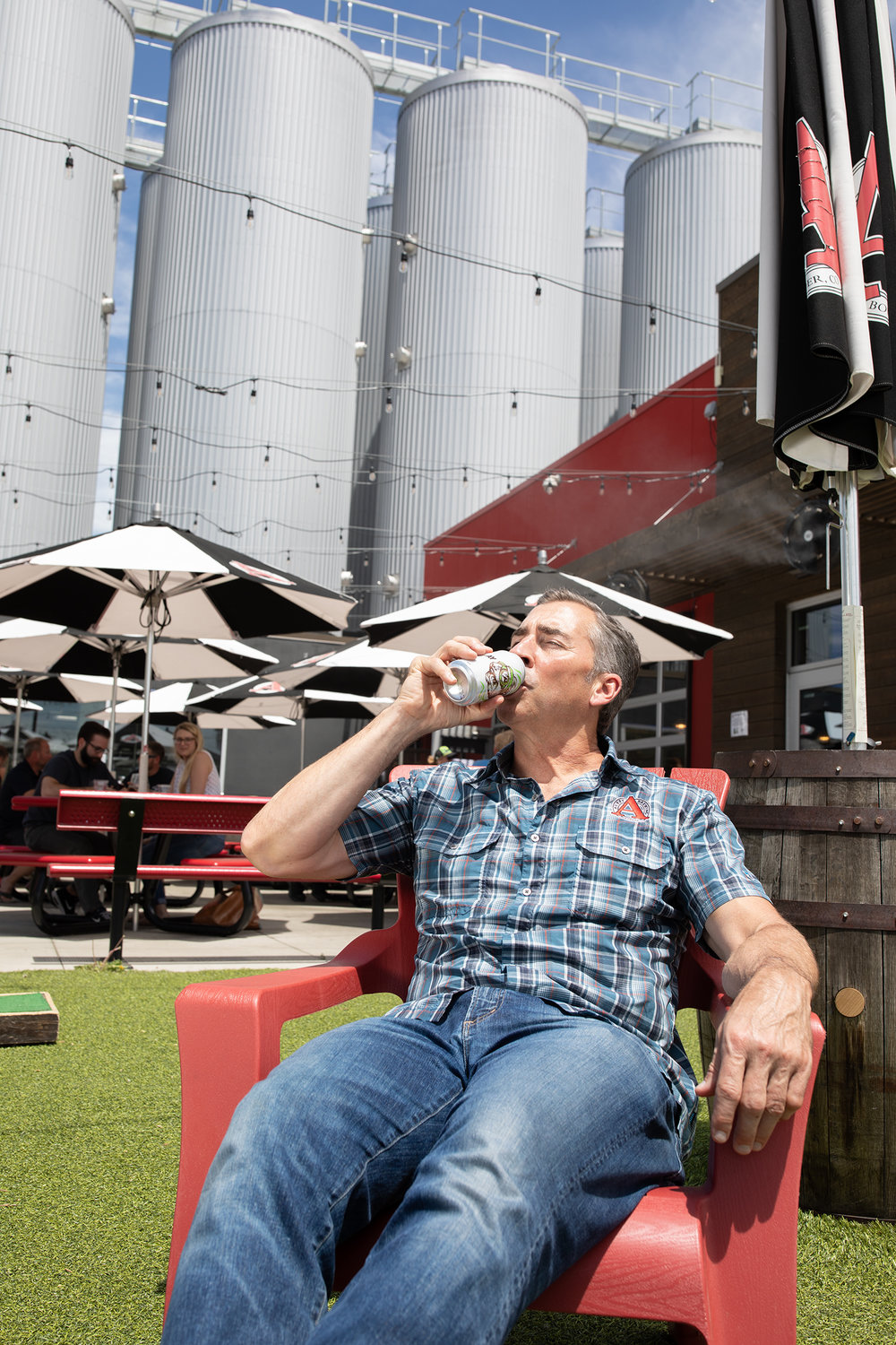 Adam Avery enjoys a sip of his Go Play IPA at the brewery.  Photo courtesy Avery Brewing Co.