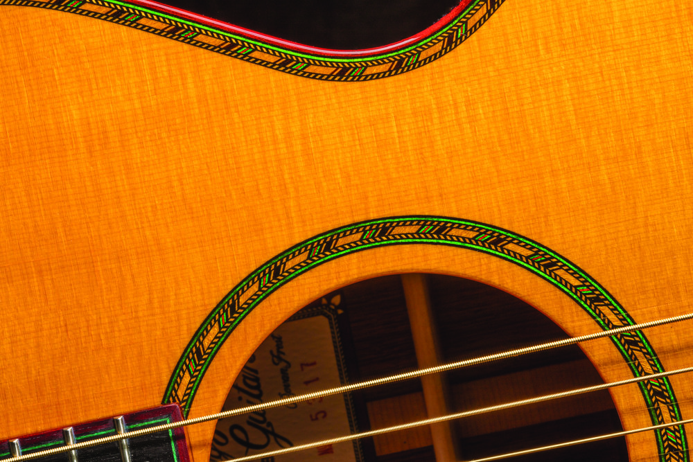 Inlay rosette and binding work are displayed. Photo courtesy Bevan Frost, Big Hollow Guitars.