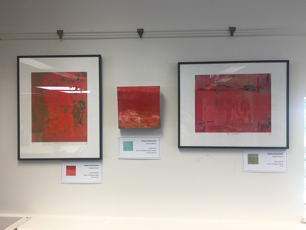 Three different red monotypes.