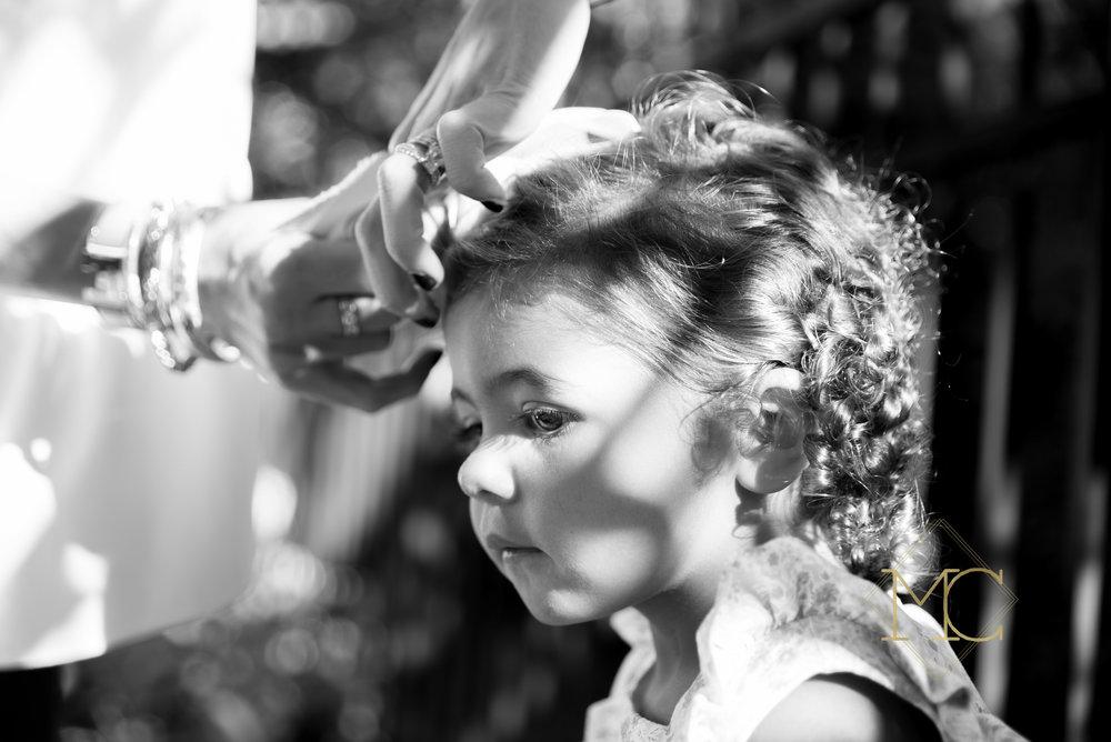 mom fixing girls hair