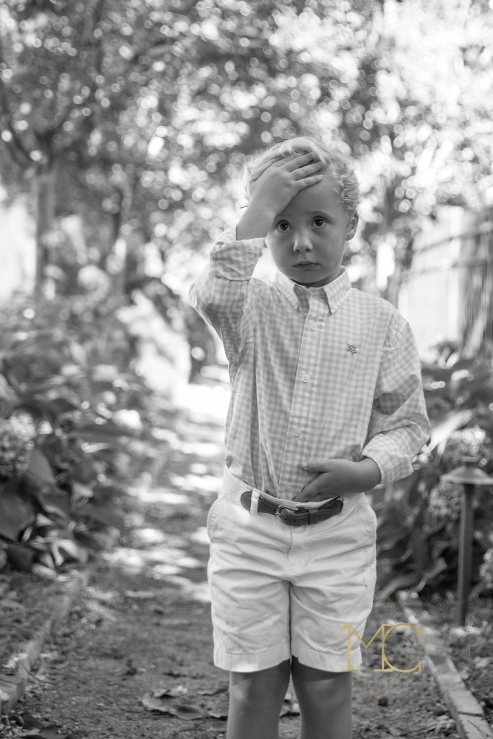 image from fall session of boy preparing his hair for photos