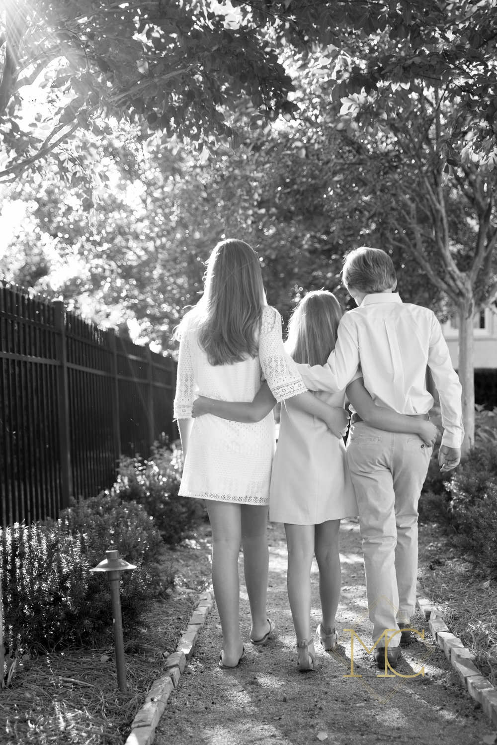 image from fall session of three siblings walking down a path