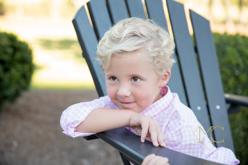 image from a fall session of a little boy looking at his grandparents
