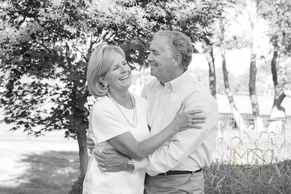image from a fall session of grandparents who have been married over 40 years