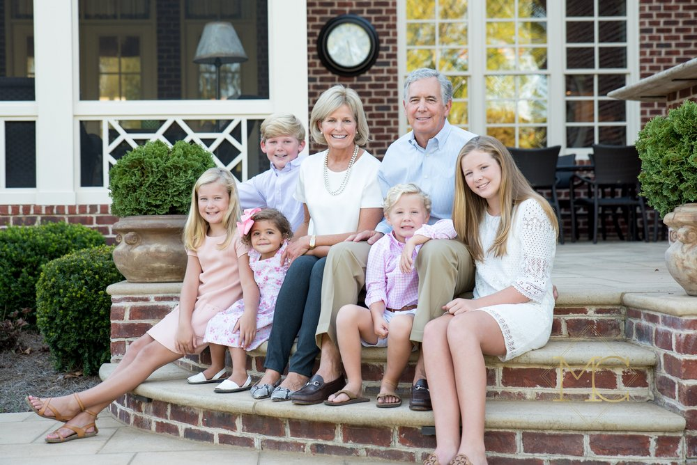 image from a fall session of grandparents with their five grandchildren at their home in brentwood, tennessee