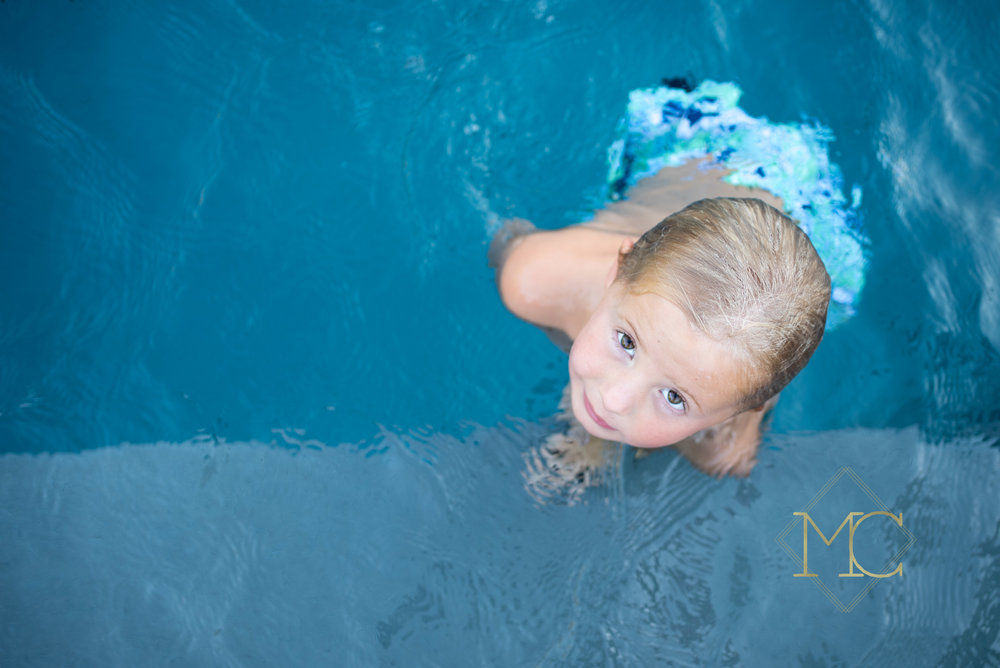 image from a fall session of a little boy in a pool