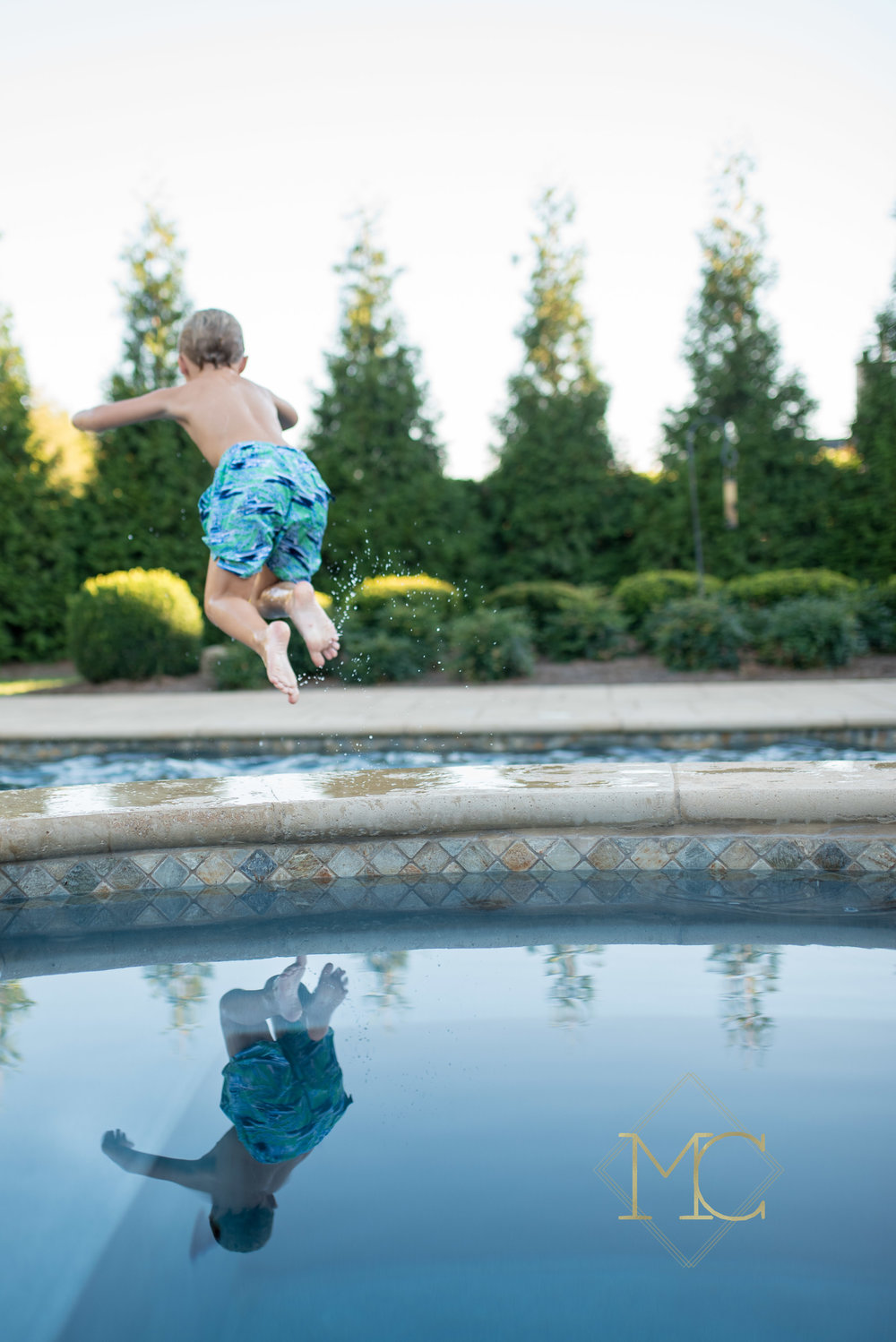 image from a fall session of a boy jumping into a pool
