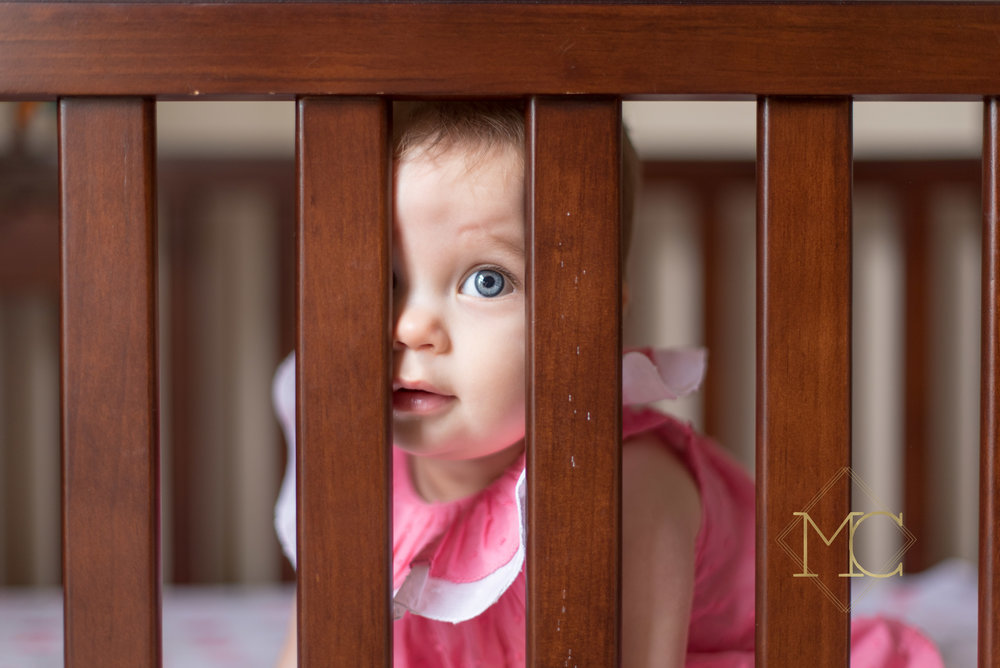 image from nashville photo session of nine month old girl in her crib