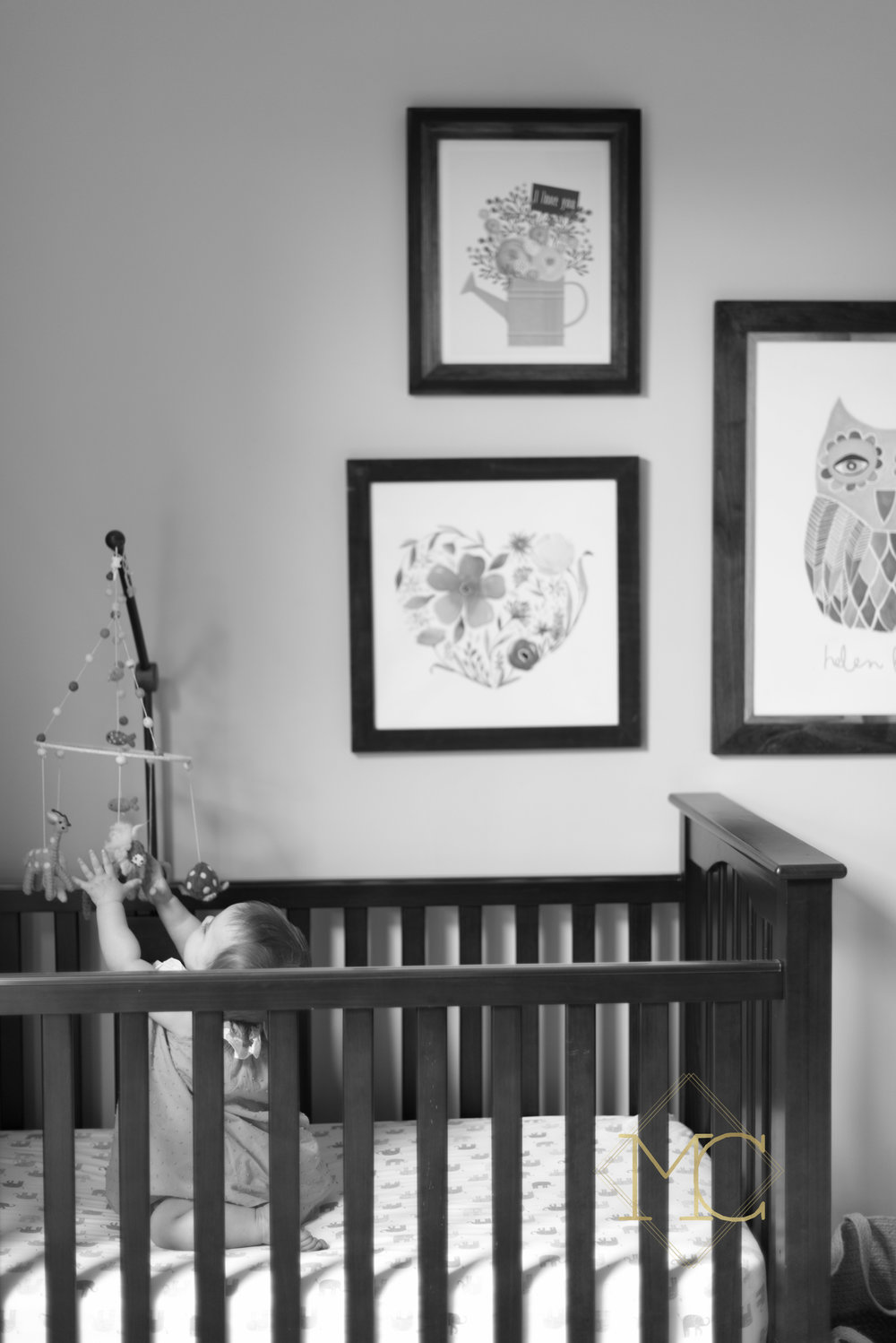 image from nashville lifestyle photo session of nine month old girl in her crib