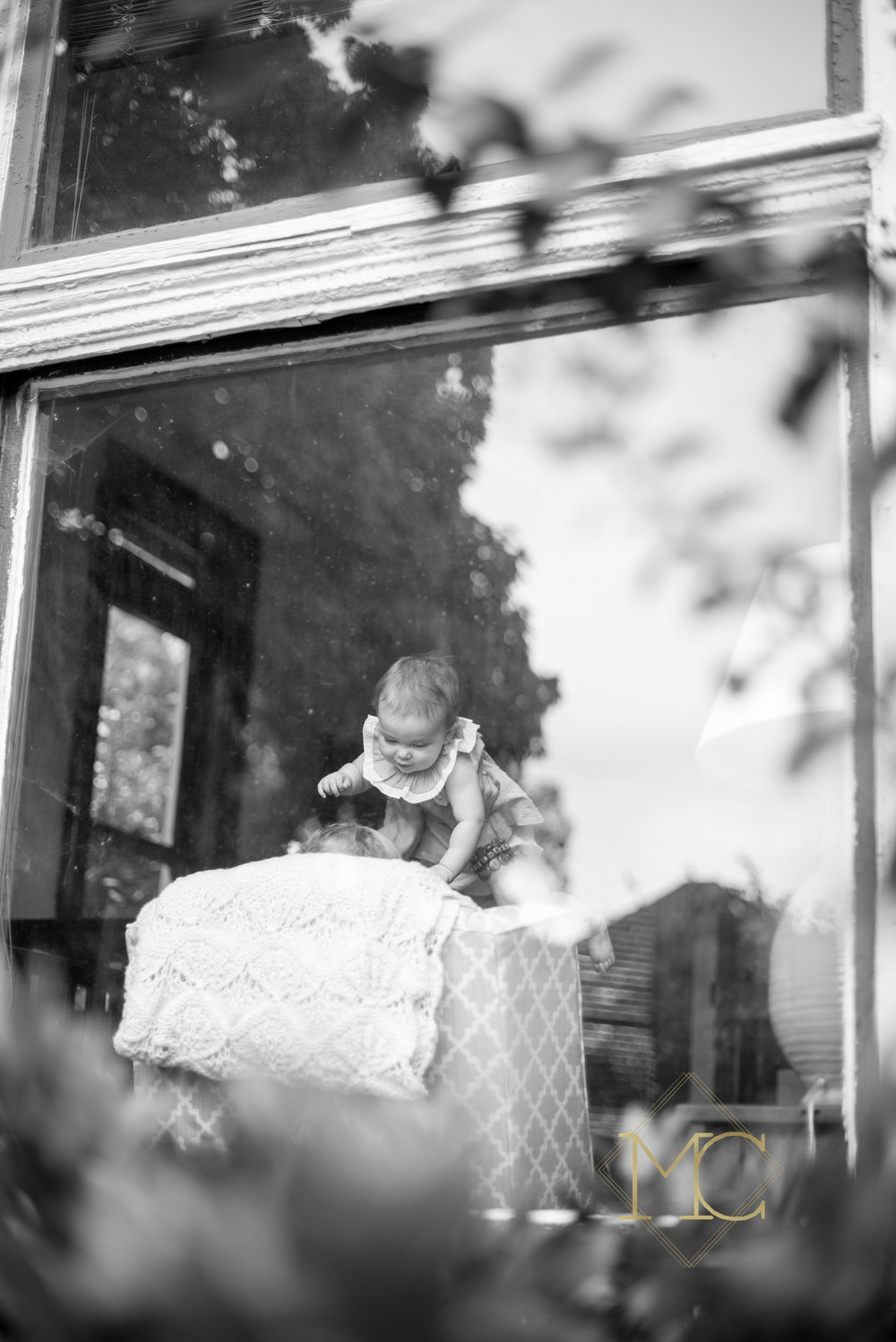 image from nashville lifestyle photo session of a mom and daughter through window