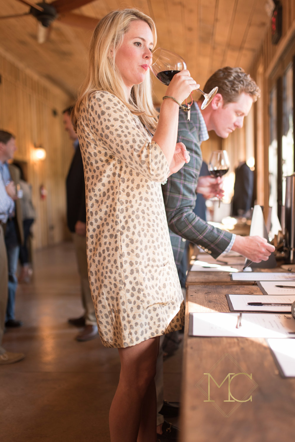 image from multiple sclerosis fall crush nashville event drinking wine and bidding on auction items