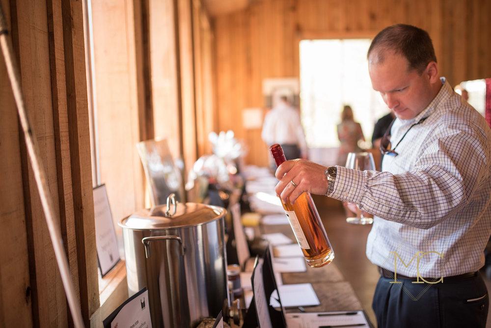 image from multiple sclerosis nashville event of man bidding on wine