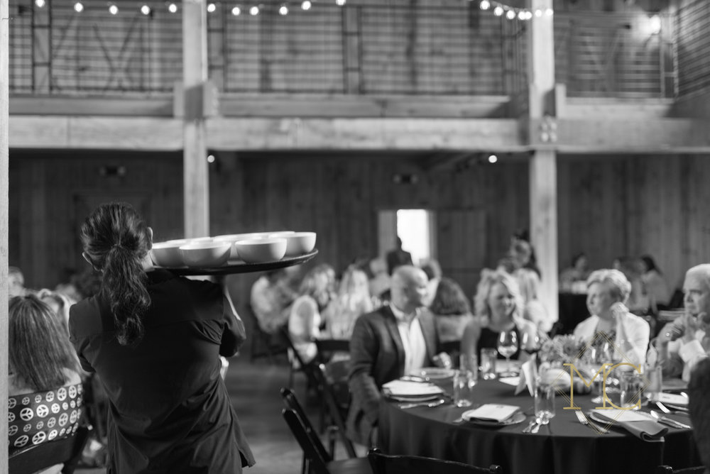 image from multiple sclerosis nashville event of woman carrying tray of bowls of lockeland table soup