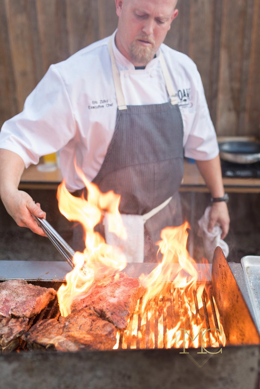 image from multiple sclerosis nashville event of chef eric zizka of oak steakhouse nashville preparing steaks