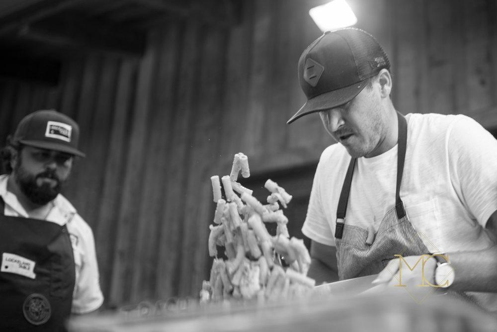 image from multiple sclerosis nashville event of chef travis mcshane of adele's nashville and chef hal holden-bache of lockeland table nashville preparing liver pate pasta