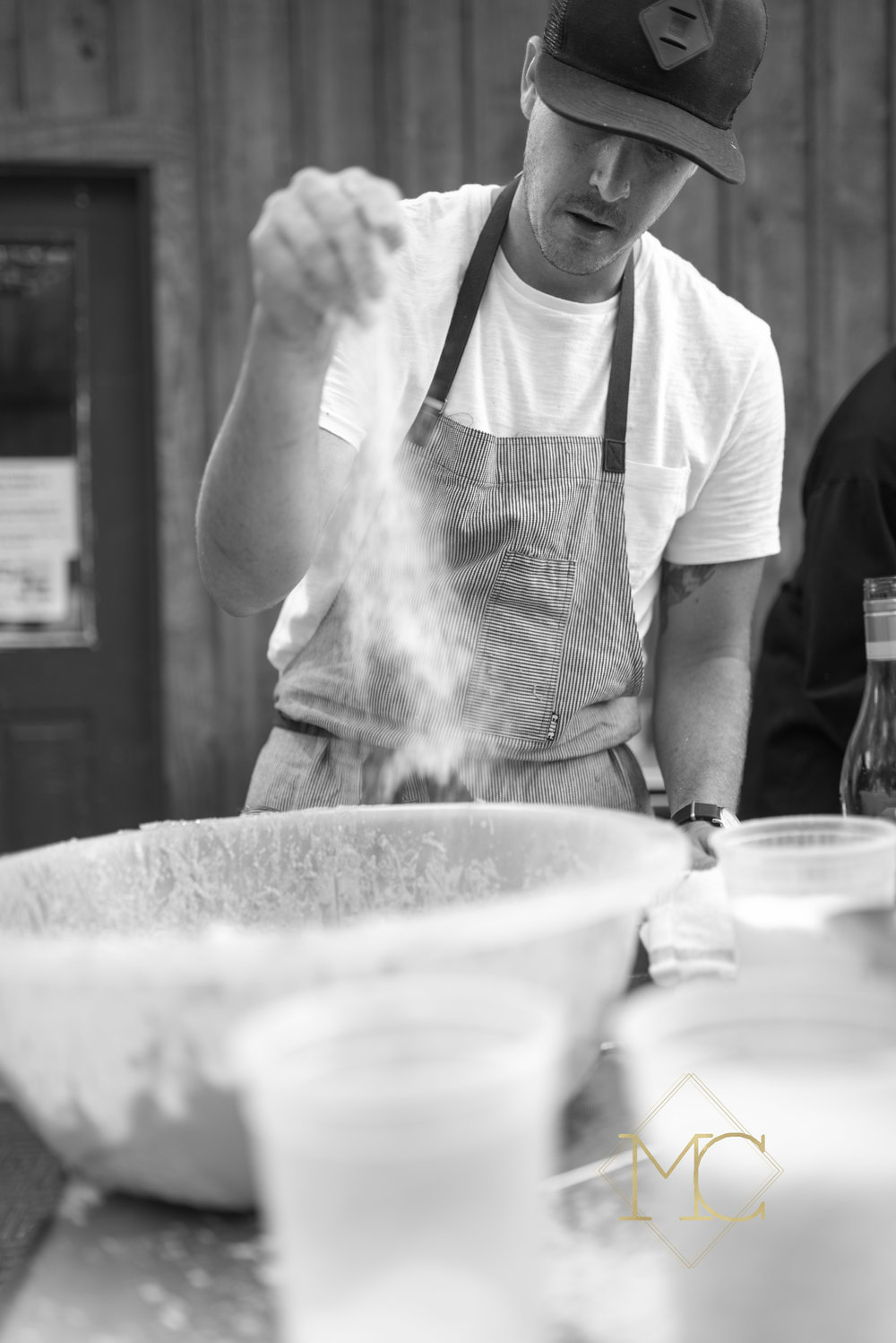 image from multiple sclerosis event of chef travis mcshane from adele's nashville preparing pasta