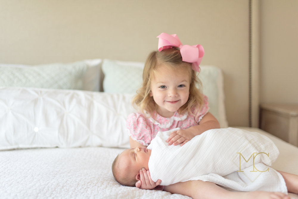 image from nashville newborn lifestyle photo session of big sister holding baby