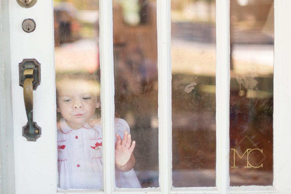 image from nashville lifestyle family photo session of toddler through window