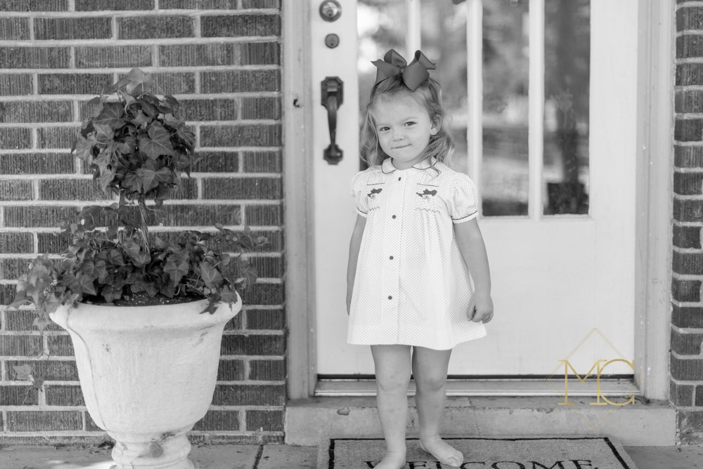 image from nashville lifestyle family photo session of toddler on front porch at home