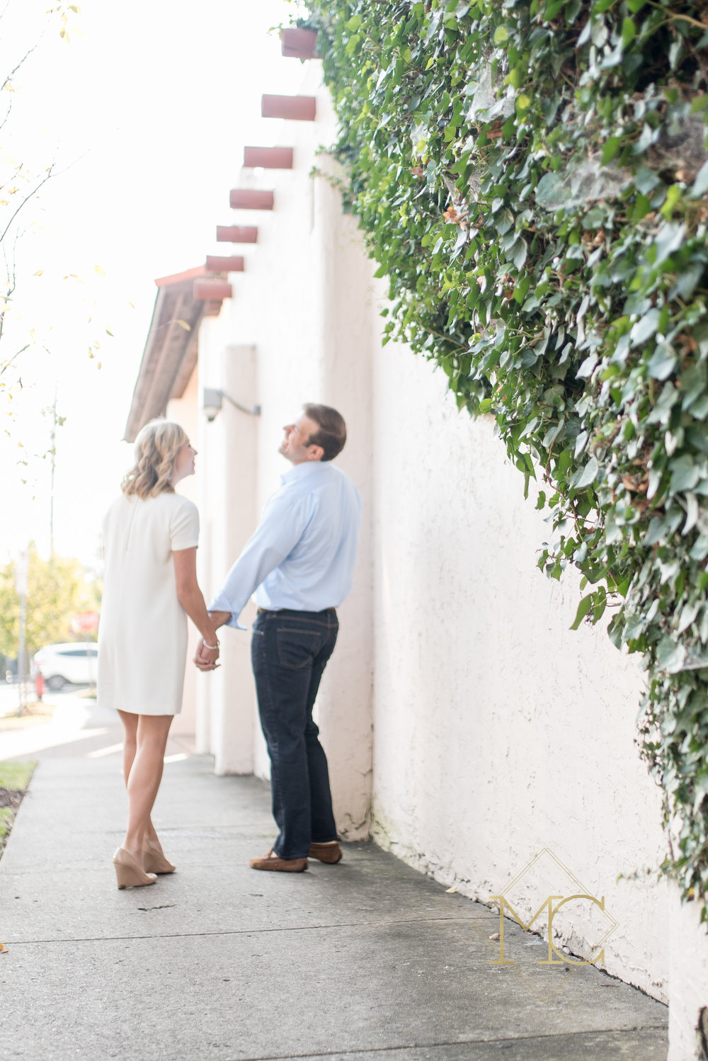 image from nashville engagement photo session of couple walking in 12 south