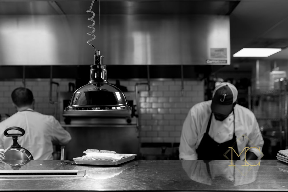 image from nashville engagement photo shoot of chef in kitchen at josephine's restaurant in 12 south
