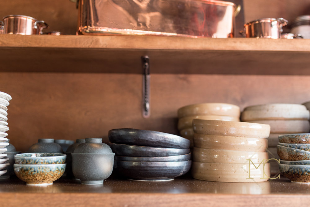 image from nashville engagement photo shoot of pottery bowls at josephine's restaurant in 12 south