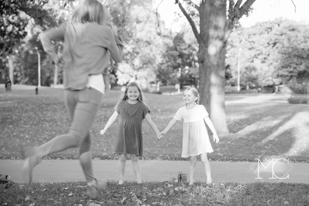 image from nashville family lifestyle photo session of a 12 south family at centennial park in fall