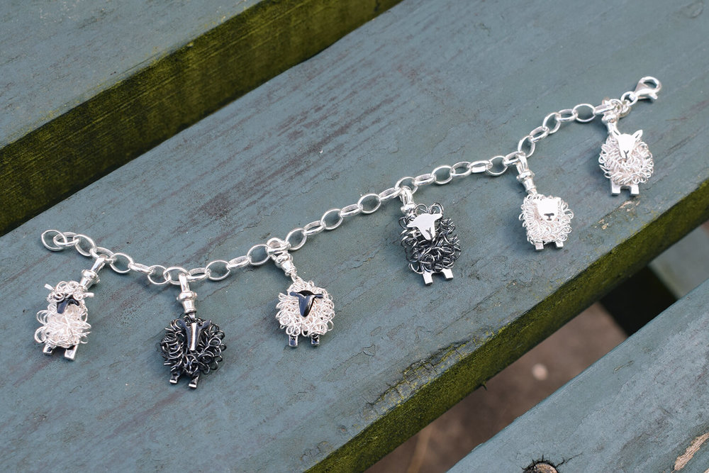 Charm bracelet with suffolk valais blacknose texel cheviot zwartbles herdwick sheep cropped colour small.jpg
