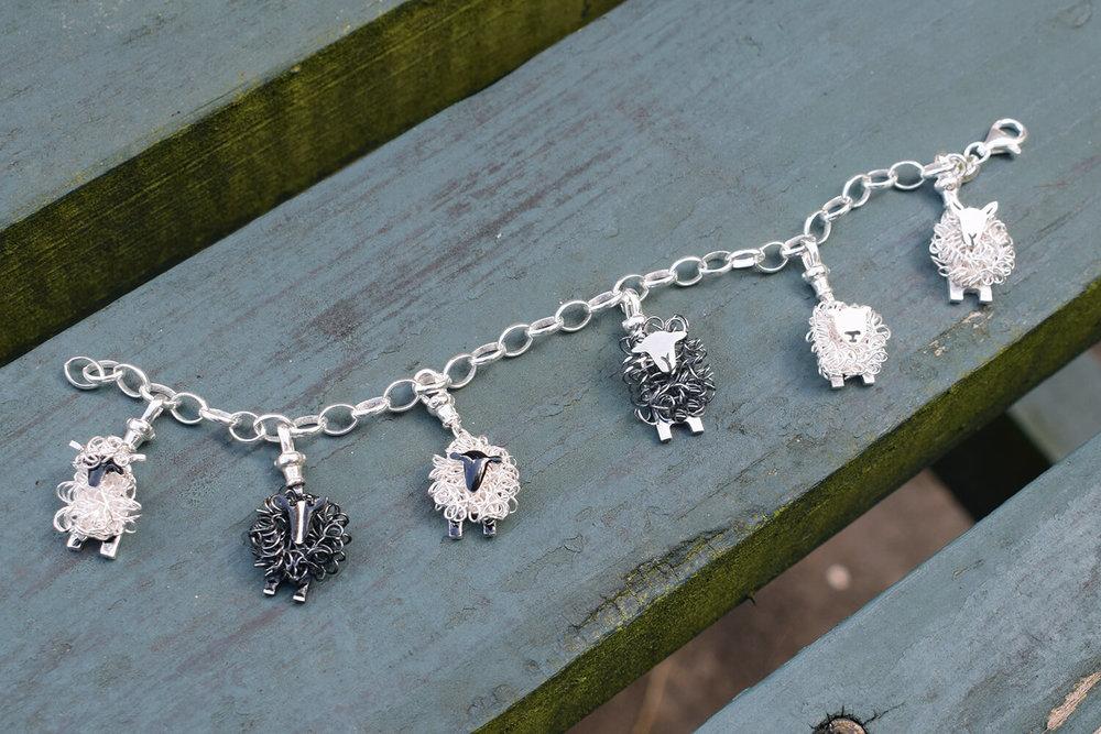 Charm bracelet with suffolk valais blacknose texel cheviot zwartbles herdwick sheep cropped colour small.jpg