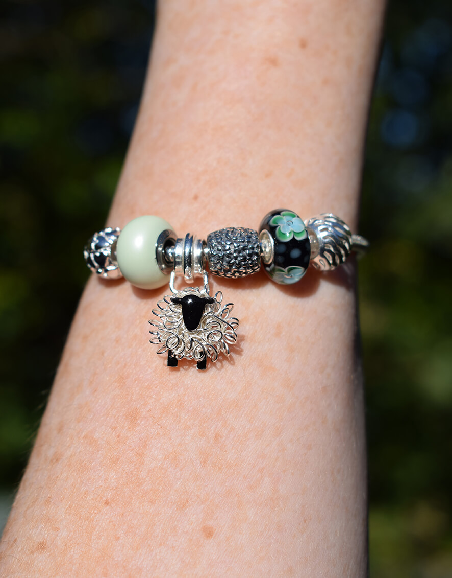 silver sheep pandora style charm bracelet on model smaller.jpg