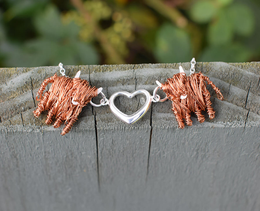 Highland cow necklace love moo flat on fence smaller.jpg