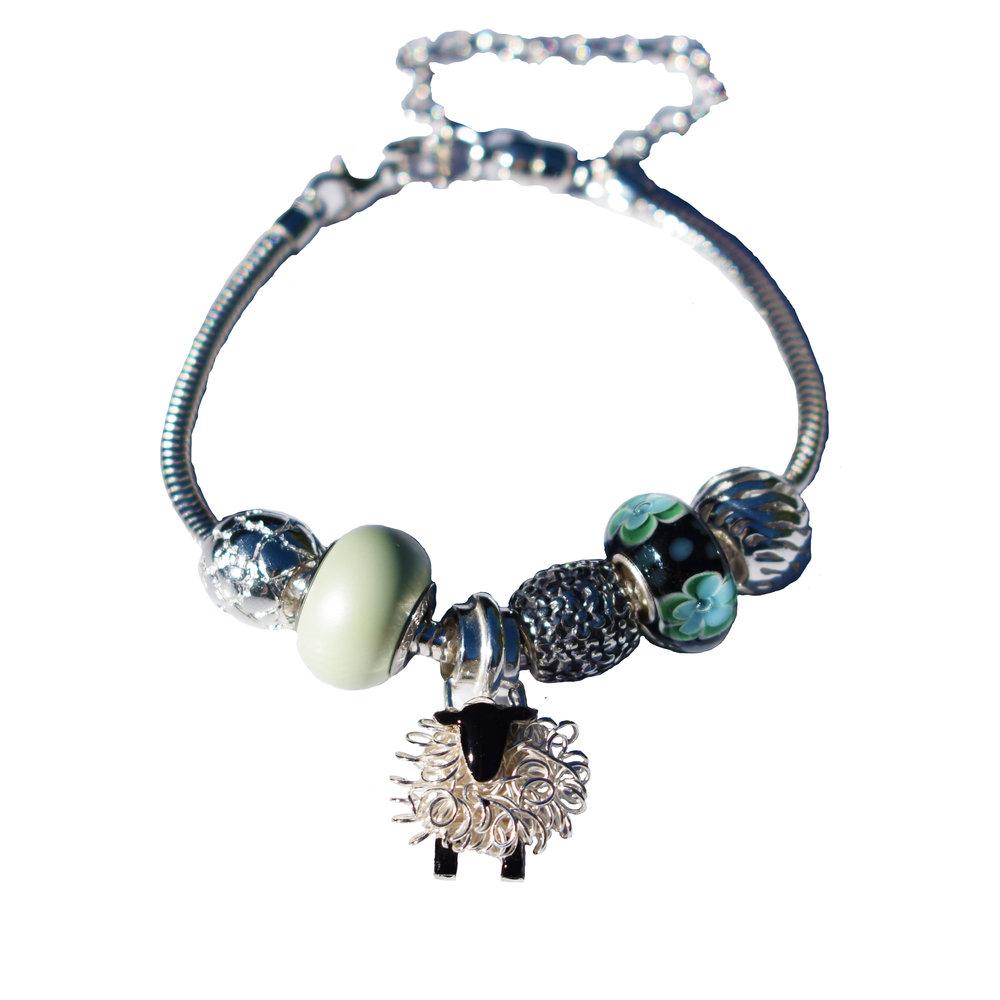 silver sheep pandora style charm bracelet.jpg