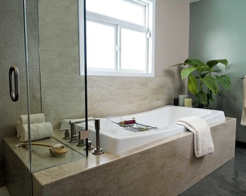 This bathroom is made with a Corian tub surround that matches the Corian shower pan and Corian shower walls. The extension of the tub surround makes a convenient shower bench.