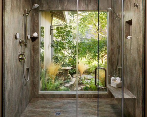 Bring the outside in with some of Corian's natural looking colors, like Rosemary in this Corian shower.