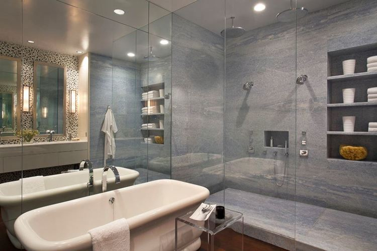 Corian shower pans are custom made to fit your space. At Countersync, the largest shower we've fabricated and installed was six feet by eleven feet!
