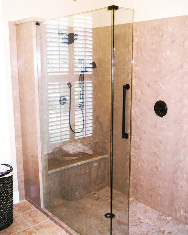 Solid surface showers are easy to clean. No grout, no mold, and no mildew! This shower in Hi-Macs color Terni is a beautiful example. #solidsurface #HiMacs #Terni #solidsurfaceshower #bathroomremodel