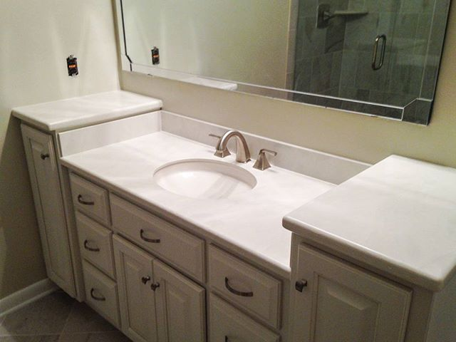 Hi-Macs Haze turned out wonderfully on this bathroom vanity! #solidsurface #HiMacs #bathroomvanity #solidsurfacecountertops