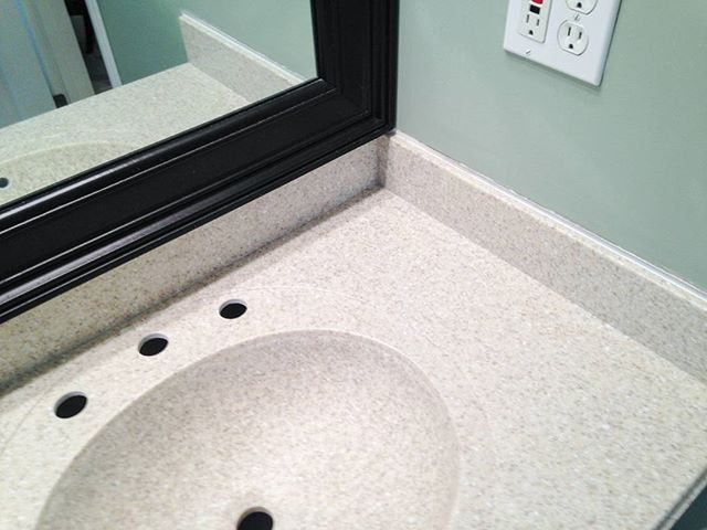 Solid surface makes integrated sinks possible! You can even make them the same color as your countertop like this one in Sahara by Corian. #ChooseCorian #Corian #solidsurface #bathroomvanity #vanitycountertop