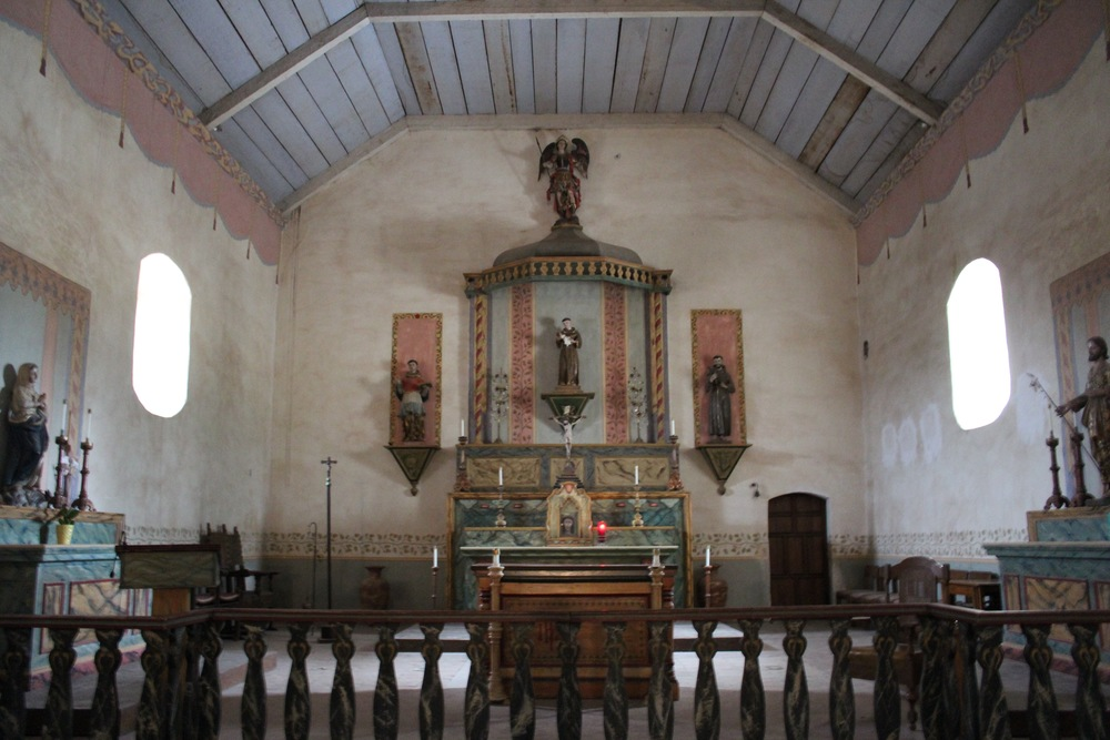 "This is a view of the altar of the church, which has a small but devoted parish. At the foot of, and below the main altar, are the graves of Padre Buenaventura  Sitjar, who helped found the mission, and who lived from 1739-1806;  Padre Francisco Pujol, 1762-1801; Padre Juan Bautista Sancho, 1772 or 1776-1830; Padre Vicente Francisco de Sarria, 1767-1835, who died of starvation at Mission Nuestra de Soledad and was carried by Indian to Mission San Antonio for burial; and Reverend Doreteo Ambris, who arrived at the mission in 1851 and who died there in 1882. Each was a very accomplished man—look them up!        0   0   1   13   76   N/A   1   1   88   14.0                      Normal   0           false   false   false     EN-US   JA   X-NONE                                                                                                                                                                                                                                                                                                                                                                              /* Style Definitions */ table.MsoNormalTable 	{mso-style-name:""Table Normal""; 	mso-tstyle-rowband-size:0; 	mso-tstyle-colband-size:0; 	mso-style-noshow:yes; 	mso-style-priority:99; 	mso-style-parent:""""; 	mso-padding-alt:0in 5.4pt 0in 5.4pt; 	mso-para-margin:0in; 	mso-para-margin-bottom:.0001pt; 	mso-pagination:widow-orphan; 	font-size:12.0pt; 	font-family:Cambria; 	mso-ascii-font-family:Cambria; 	mso-ascii-theme-font:minor-latin; 	mso-hansi-font-family:Cambria; 	mso-hansi-theme-font:minor-latin;}       The church is in the middle of a seismic retrofit. July 2015."