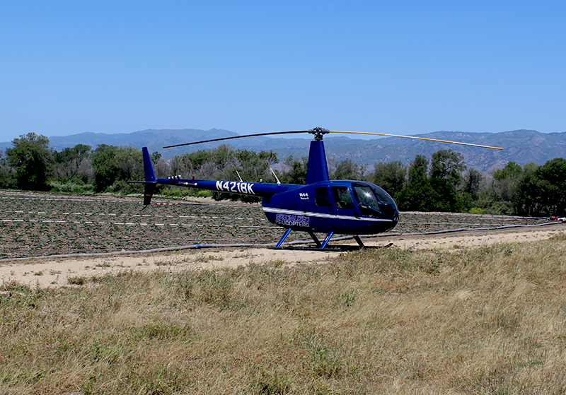 Specialized Aviation's four-seater helicopter waiting for its passengers at Odonata Winery's tasting room.
