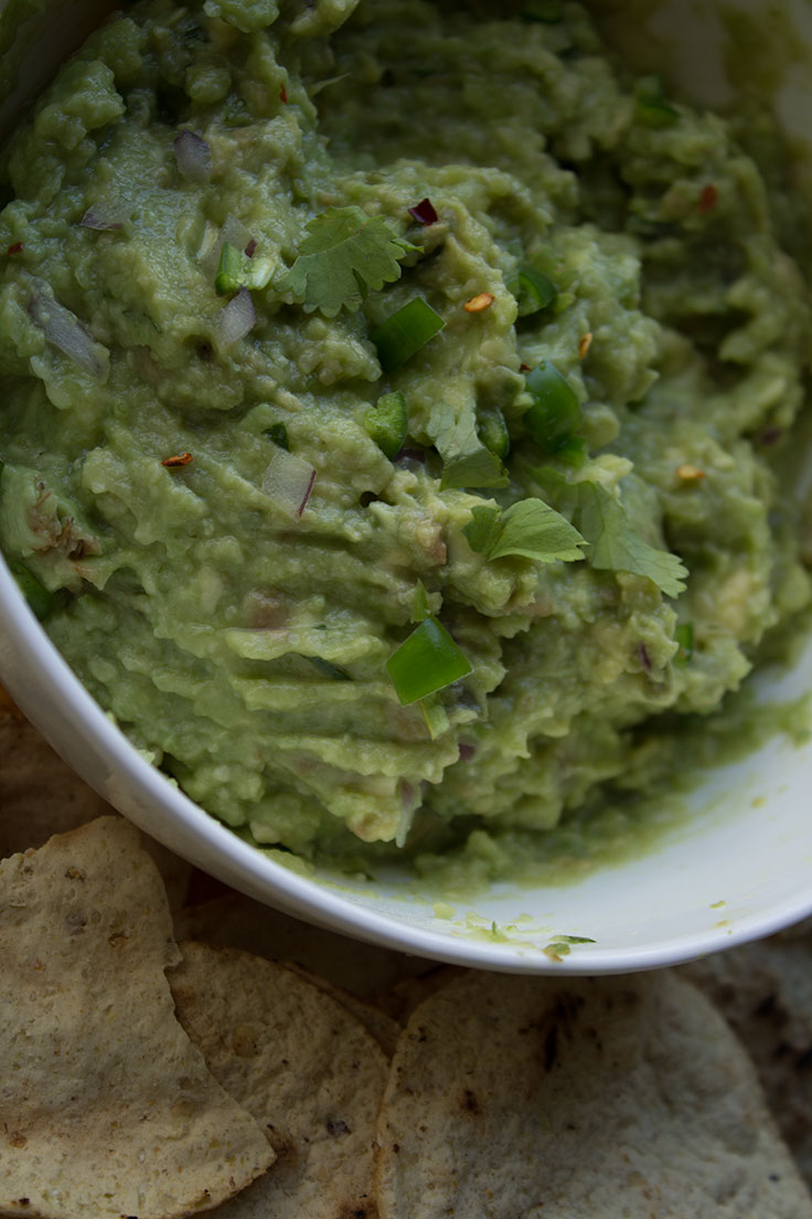 "Just about everyone I know has a go-to guacamole recipe that they swear is the best. I say, there's no such thing as the ""best"" guacamole recipe because everyone has different preferences when it comes to the flavors and textures of their guacamole. Me? I prefer my guacamole a little bit chunky, with hidden, unexpected flavors. Some people enjoy tomatoes in their guacamole, but I reach for a tiny bit of mined Serrano Chile, a little bit of garlic, and celery."