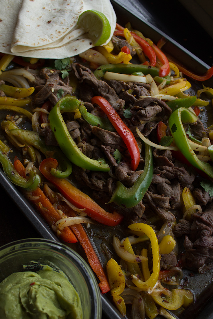 These one sheet pan beef fajitas are the perfect solution for busy weeknights. #onesheetpandinner